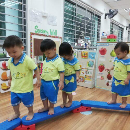 Children walking on balancing beams