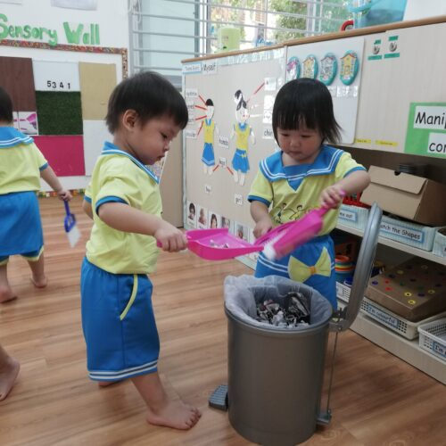 Children cleaning the classroom
